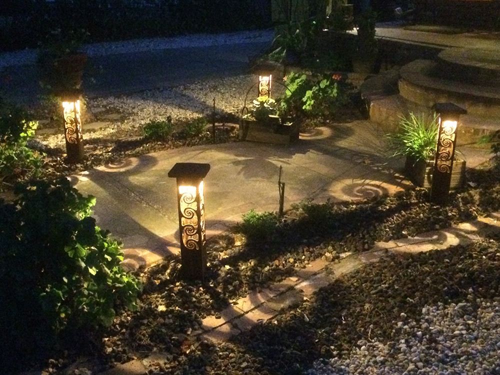 custom metal sculptural landscape lighting sestak lighting design
